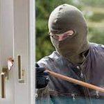 A Burglar Breaking Window